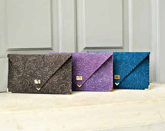 3D flower pattern leather clutch in multiple colors