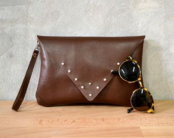 Brown leather wrislet clutch with silver metal studs