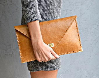 Camel brown leather clutch