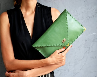 Pastel green leather clutch