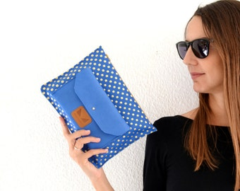 Blue leather clutch with gold dots and zipper