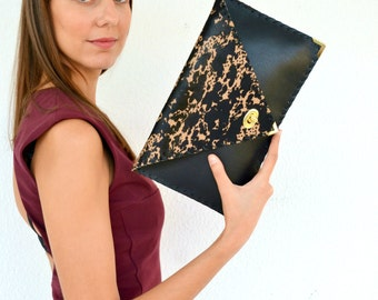 Leather black clutch with hairy, animal print leather