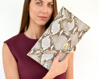 Snake print leather clutch