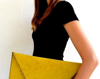Large mustard yellow leather clutch