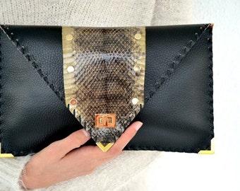 Black leather clutch with genuine snakeskin