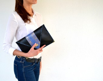 Black leather clutch with blue snakeskin