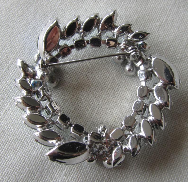 Vintage silver tone blue rhinestones wreath brooch
