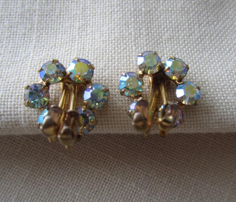 Vintage gold tone Keyes screw back earrings with brown rhinestones