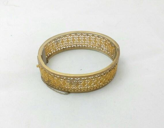 Napier Gold Tone Brass Cuff Bracelet,  Depression