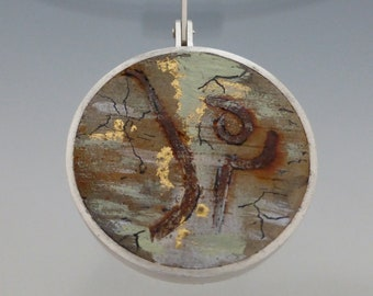 Concrete and steel pendant set in sterling