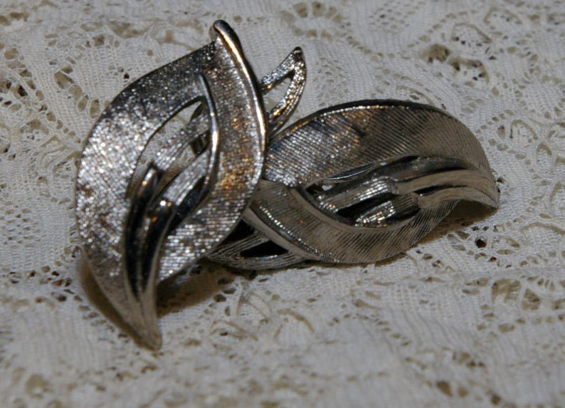 Unique Vintage 1960s Silver Tone Leaf Clip On Earrings image 0