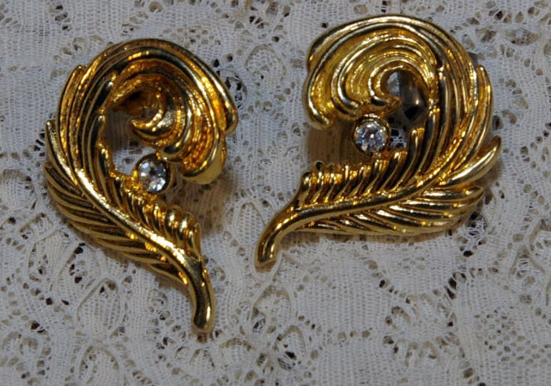 Vintage Gold Tone Feather Curled Around Rhinestone Earrings image 0