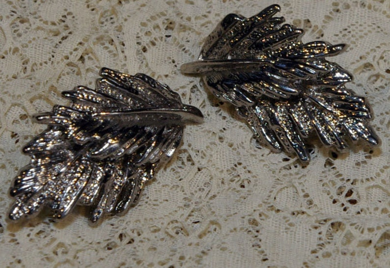 Vintage 1960s Silver Tone Double Feather Earrings image 0
