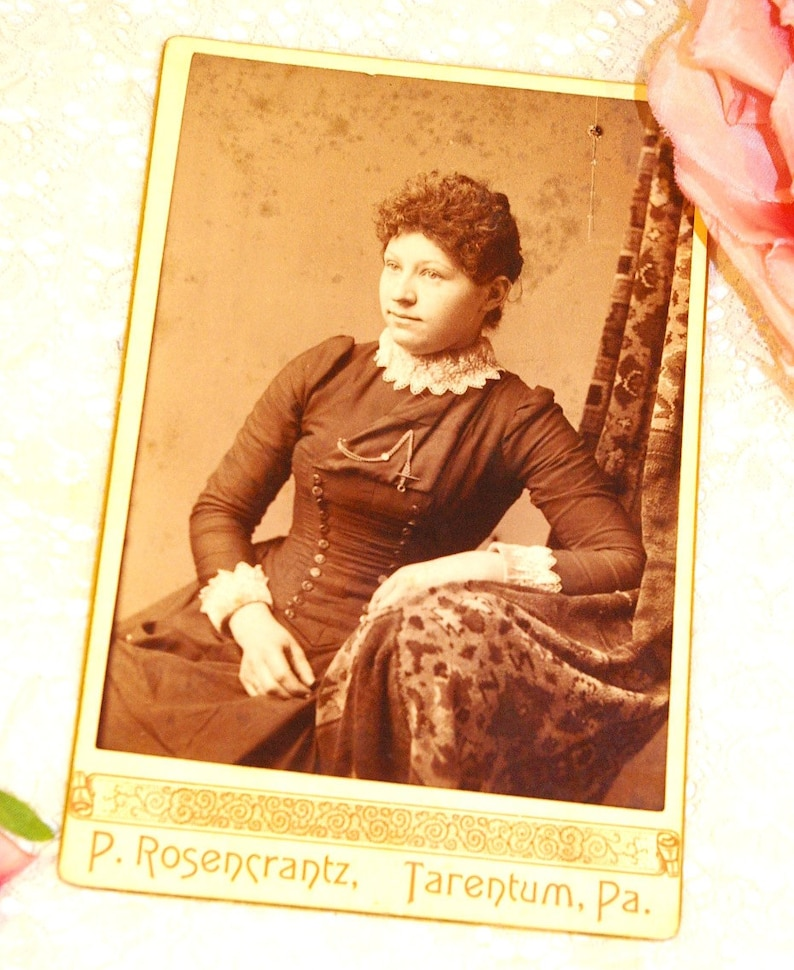 Antique Sepia Photograph of a Young Woman in Victorian Fashion image 0