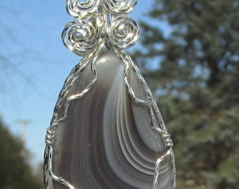 Botswana Agate Cabachon wire wrapped pendant in Argntium Sterling Silver