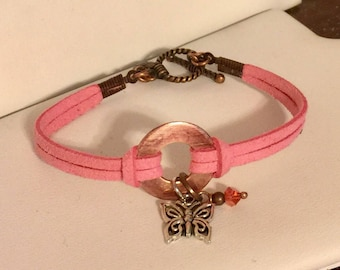 Copper pink faux suede bracelet with toggle clasp, with silver plated butterfly and pink swarovski bead dangle