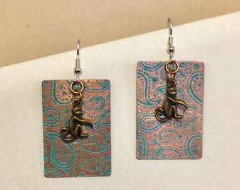 Copper etched paisley, hand painted earrings with Sterling silver earwires and monkey charms