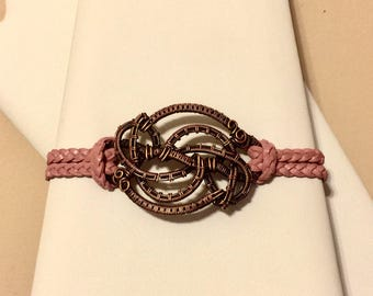 Copper wire wrapped bracelet with pink leather and toggle clasp