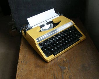 Fab Yellow silver reed manual typewriter in great condition with new ribbon fitted,fully working.Free UK postage