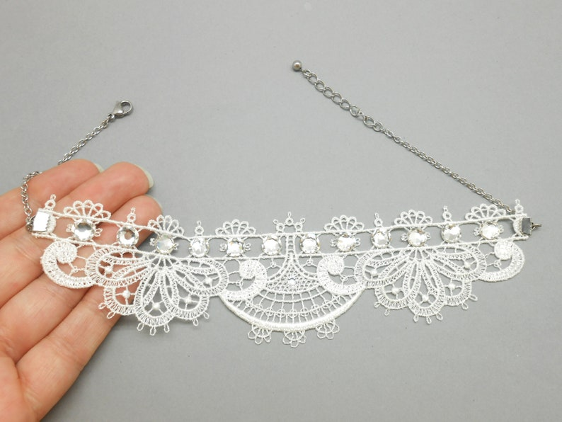 White lace neck tower with crystal rhinestones