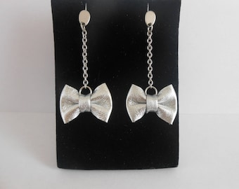 Steel with silver leather knot earrings