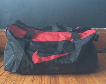 3ba86d2e9d27 Vintage 90 s Nike Red and Black Nike Swoosh Gym Duffel Bag (free shipping)