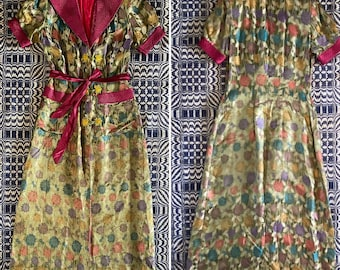 Vintage 1940s brocade hostess robe. Short puffed sleeves, shoulder pads, stitched details
