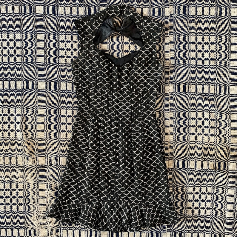 Keyholes and Ruffle Hem. Wounded Bird 1950s Black Wiggle Dress with Silver Embroidery