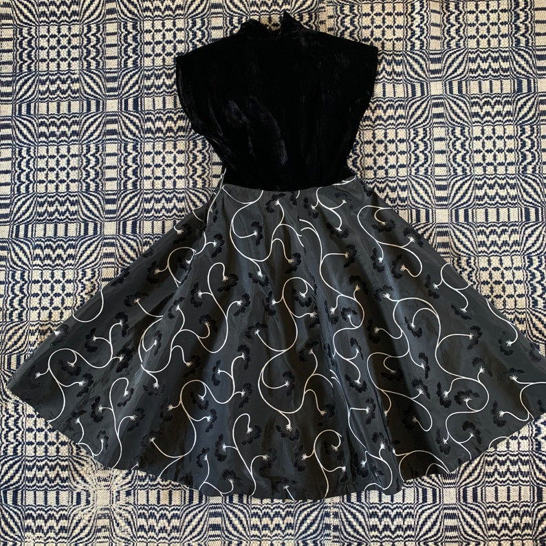 Late 1940s  Early 1950s Black Velvet and Taffeta Party Dress with Painted Vines and Pockets