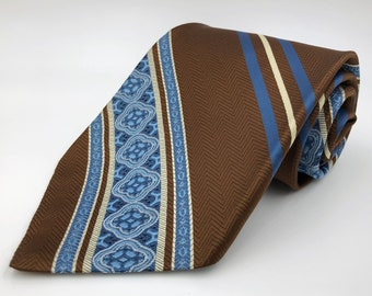 be031b7adbd2 Vintage 1970s Wide Brown Polyester Tie with Blue and Yellow Patterned Stripe  by Wembley