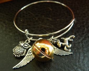 Golden Brass Ball Locket Adjustable Bangle. Wing Charms.Wizard.Magical.