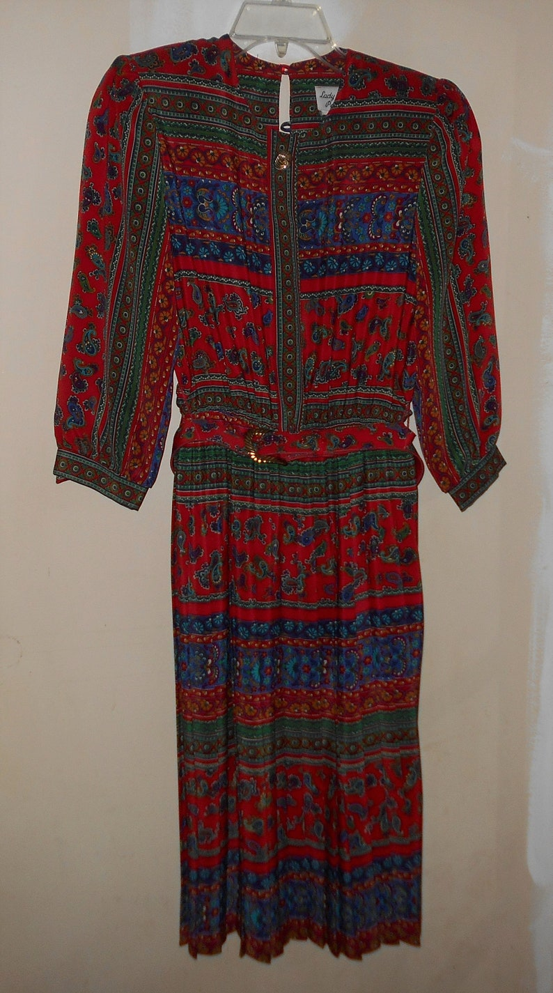 1970s Union Made USA Size 8 Petite vibrant colors and pattern Lady Carol Bust to 36 Vintage red Secretary dress