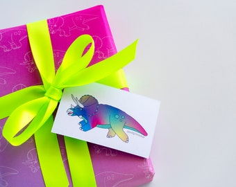 Triceratops rainbow wrapping paper with tags