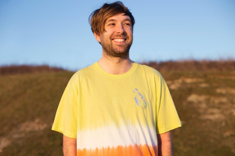 tie dye t-shirt in sulphur yellow and coral with a image 0