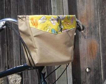Large tan handlebar bag sandal print