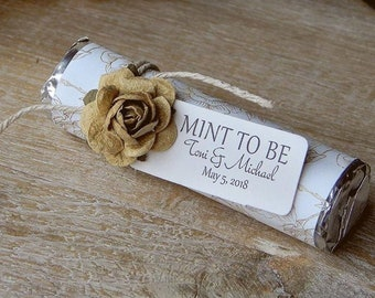 mint rolls with personalized wrappers MINT TO BE favors ice blue berries and leaf boughs