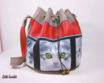 Red and taupe leather bucket bag and tissue cats