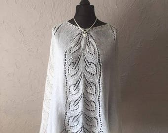Hand knitted white poncho