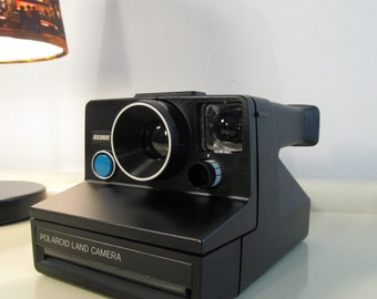 Polaroid Camera 1001 Revue Black color Blue button SX-70 type instant film with instruction manual