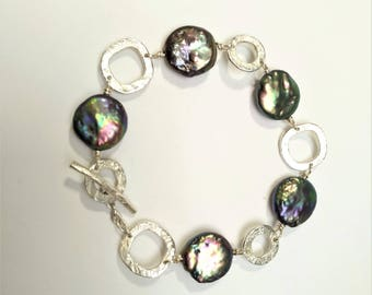 Cultured freshwater pearls and sterling silver bracelet.