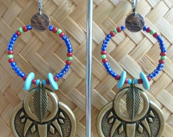 """Long ethnic earrings, colorful beads and brass """"Beads for bear claw"""""""