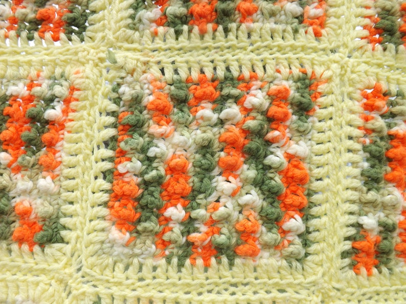 fringe avocado pale yellow Retro colors crocheted afghan and orange