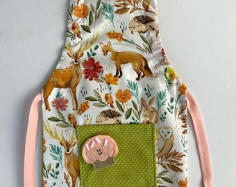 Kid Size Adjustable Double Sided Apron in Pretty Woodland Print and Green Polka Dot Back with Felt Cupcake Pocket Pal