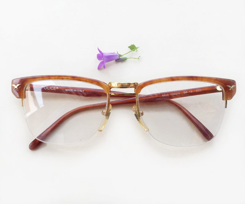 2b0fa00c7f1 Superbes Police lunettes à montures   Police 1042N lunettes de