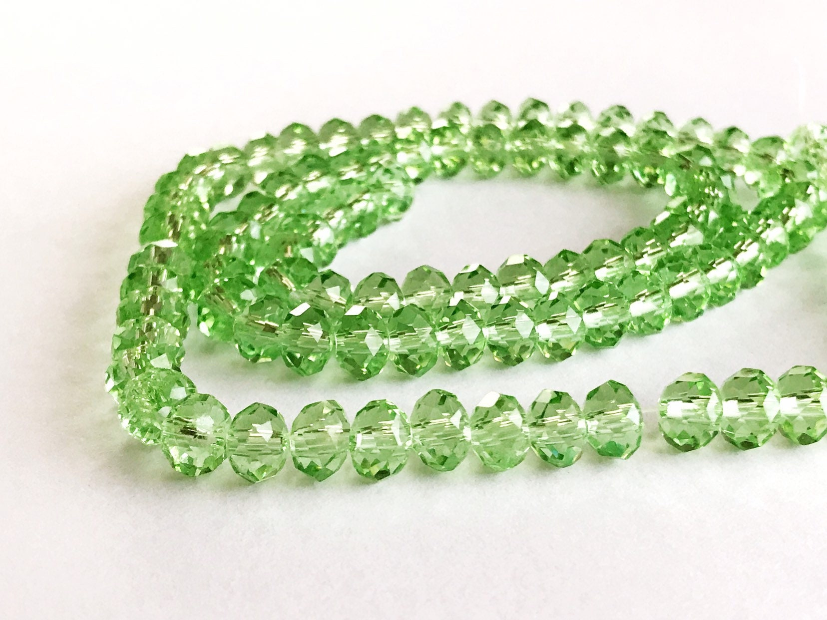 0f244af1b00ed 4 mm x 6 mm green glass rondelle x 40 faceted bead clear leaf green  crystal, 40 pcs