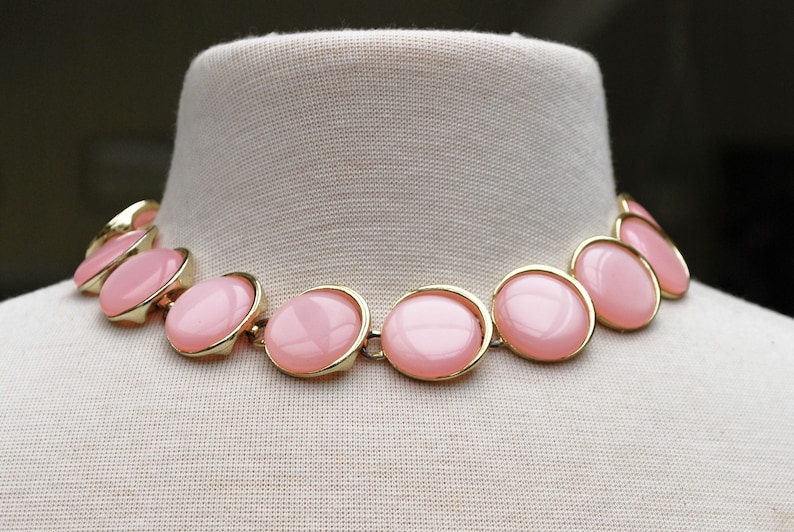 Pink Thermoset Link necklace round moonglow  Pink plastic disks   gold tone  Mid Century