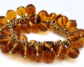 J Crew dangle bead Bracelet dark brownish orange glass beads stretch cha cha bracelet