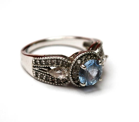Sterling Light Blue CZ ring  Signed China 925  Cubic Zirconia  Size 7 1/2 ring  silver ornate setting  clear and bluish stones
