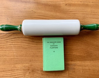 """Vintage """"Nutbrown"""" ceramic rolling pin with green, wooden handles. Made in England. Lovely piece of kitchenalia, still fit for purpose."""
