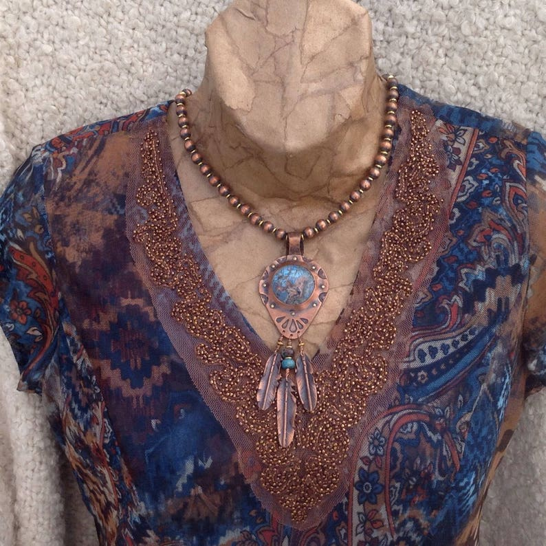 Cinda Serafin Southwestern style necklace with handmade copper feathers and regalite stone pendant Copper and brass beaded necklace
